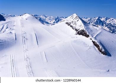 Skiers, ski lifts, runs and pistes on Hintertux Glacier in Zillertal Apls in Austria.