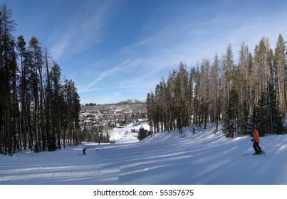 Skiers slide down to the resort base area in Steamboat Springs, Colorado