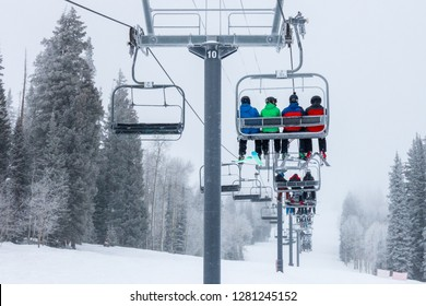 Skiers and snow boarders ride the chairlift to the top of Mount Werner, a Steamboat Springs Ski Resort, in the Rocky Mountains of Colorado.
