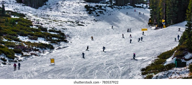 Skiers and snowboarders descend the slopes at Northstar Ski Resort, in the Sierra Nevada Mountains of California.