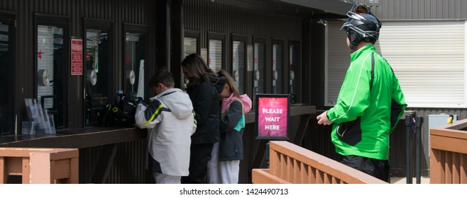 Skiers waiting to buy lift tickets at the counter