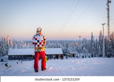 Skier/snowboarder in Oslo Winter Park during winter holidays at sunset.