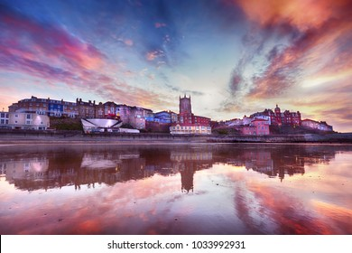 Skies ablaze in Cromer town - Fabulous looking sky and reflection surround the picturesque seaside town of Cromer. As dusk appears, the soft lights of streets and buildings come on.