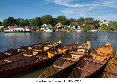 Skiff boats are moored on River Thames in Berkshire, England, UK