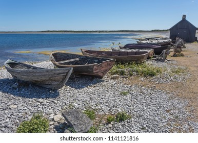 Skiffs on the beach of Faro, Gotland Sweden at the old fishing village Helgumannen which was used during the 19th century and the early part of the 20th century by local farmers