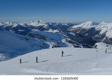 Skiiers going down a slope