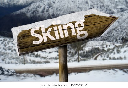 Skiiing wooden sign with a snow background