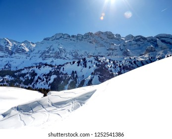 Skiing in the Alps  , between Switzerland and France.