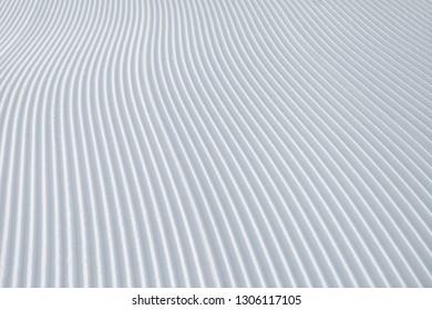 Skiing background - fresh snow on ski slope. Powder, alps.