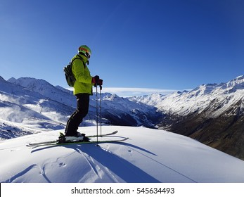 skiing background, skier in beautiful mountain landscape, winter holidays in Alps