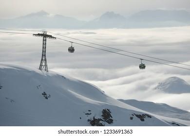 Skiing cabin lift above the clouds in the French Alps, Paradiski, La Plagne