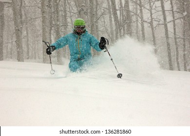 Skiing during a snow storm with aspen trees, Utah, USA.