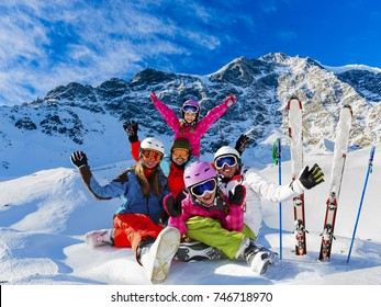 Skiing family enjoying winter vacation on snow in sunny cold day in mountains and fun. South Tirol, Solda in Italy.