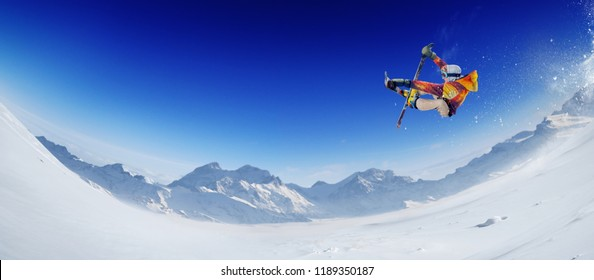 Skiing. Jumping skier. Extreme winter sports. Panorama.