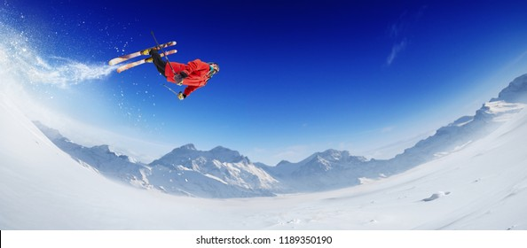 Skiing. Jumping skier. Extreme winter sports. Panorama.