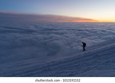 Skiing man in snow covered mountains