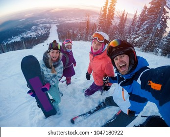 skiing on ski Team of friends makes selfie photo of herself with snowboards and skis. action camera. Sunset. Sheregesh, Kemerovo region, Russia.