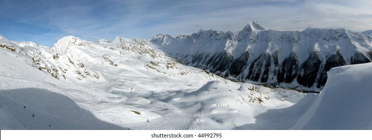 Skiing on a Swiss glacier, huge wide-angle panorama