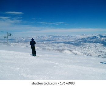 Skiing from the peak of the mountain in Snowmass, Colorado