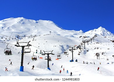 skiing , snowboarding tourists on the beautiful winter snow Mountain Ruapehu in the Northern island of New Zealand on a bright sunny day.