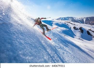 Skiing in the snowy mountains, Carpathians, Ukraine, good winter day, ski jump, fall, ski season