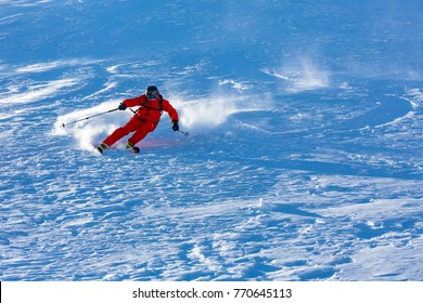 Skiing in the snowy mountains, Carpathians, Ukraine, good winter day, ski season.