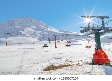 Skiing track and the ski lift cabins on snowy slopes of mountains. Saklikent situated on the northern side of Bakirli Mountain. Antalya-Turkey