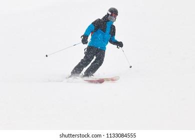 Skiing under the snow. Winter sport. Ski slope. Horizontal