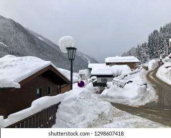 Skiing village Saalbach-Hinterglemm facing massive snowfalls during a blizzard