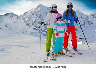Skiing, winter - family skiers on ski slope