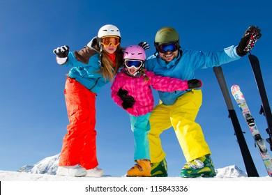 Skiing, winter fun - family ski team enjoying ski holidays