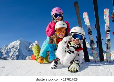 Skiing, winter, snow, sun and fun - skiers enjoying winter vacations