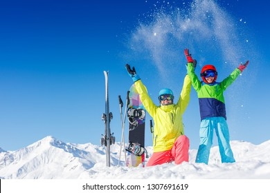 Skiing, winter, snow, sun and fun - kids, boy and girl having fun in the Alps. Child skiing in the mountains. Vacation and outdoor snow fun.