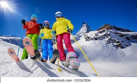 Skiing, winter, snow, sun and fun - family enjoying winter vacations in Zermatt, Switzerland.