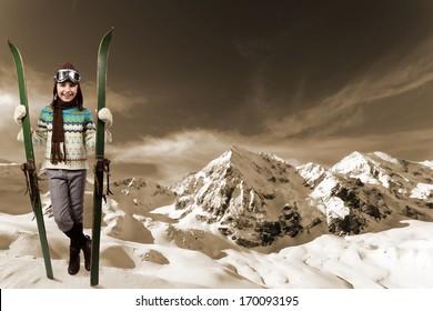 Skiing, winter vacation - girl with retro ski equipment
