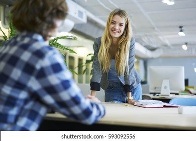Skilled female blonde HR manager of business company conducting interview with young male student wanting to start career of IT developer finishing university answering questions on meeting in office