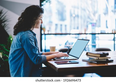 Skilled freelancer checking received information on modern laptop computer with blank screen, Caucasian female student preparing to university exams while e learning on netbook in coworking space