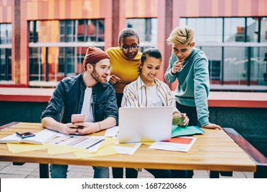 Skilled male and female millennials browsing mobility website for reading positive news on social website connecting to 4g wireless internet on modern smartphone device,group of friends watching video