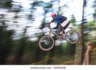 A skilled mountin biker leaps off of a jump near Hood River, Oregon.