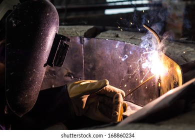 Skilled technicians are welding steel plates to produce arc furnace.
