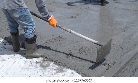 Skilled workers are working to concrete roads.