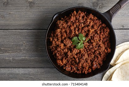 skillet with chorizo and tortillas