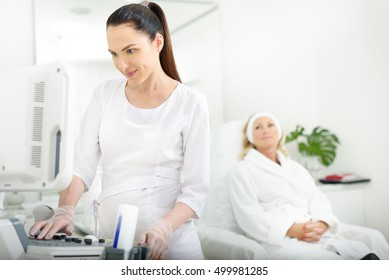 Skillful doctor using ultrasound machine at clinic