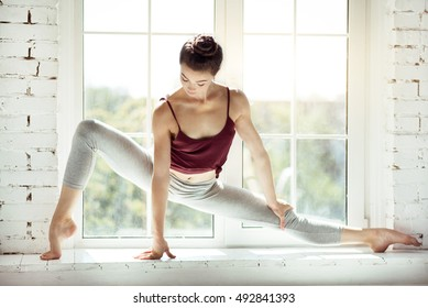 Skillful modern dancer sitting in a position