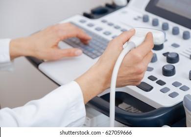 Skillful sonographer using ultrasound machine at work