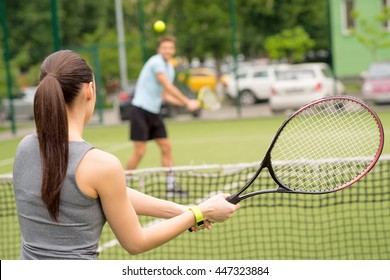 Skillful tennis players competing in stadium