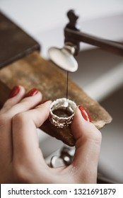 Skillful work. Close up of a female jeweler's hand working on a ring resizing at her workbench. Ring Resizing.