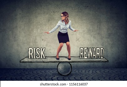 Skillful young business woman balancing between reward and risk in challenging corporate environment