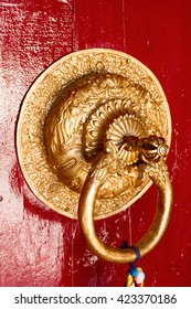 Skillfully made and richly decorated door handle of a Buddhist temple in the Himalayas (the monastery Spituk, Leh, Northern India)