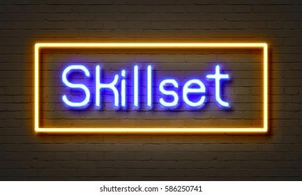Skillset neon sign on brick wall background